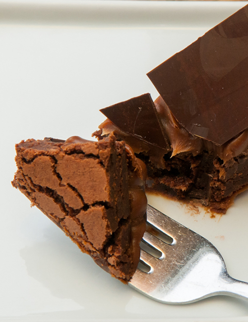 closeup of a brownie bite on a fork