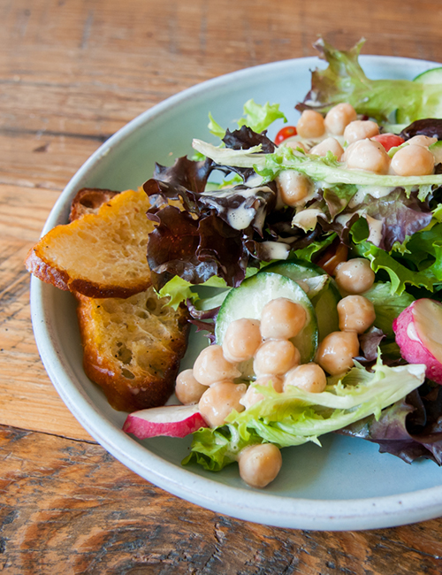 tasty little salad on a plate, with chick peas and fresh croutons