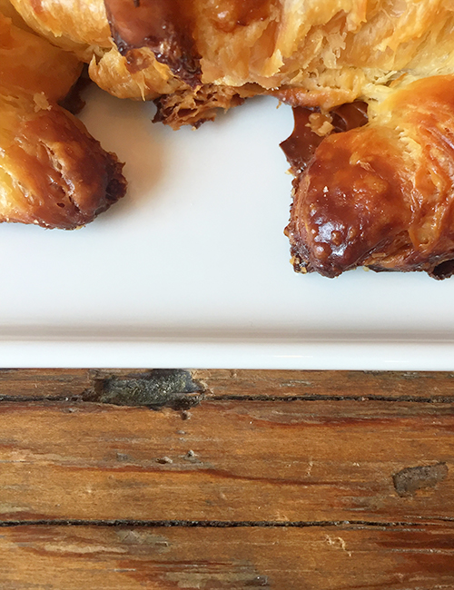 closeup of classic butter croissant crunchy edges