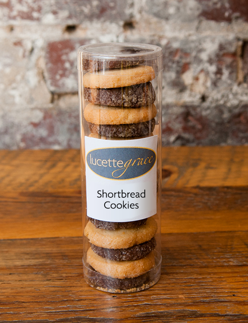 chocolate and vanilla shortbread cookies in a plastic tube container