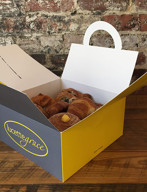 small catering box of assorted breakfast pastries