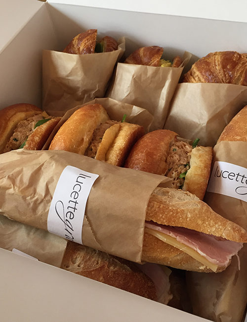 catered box of an assortment of sandwiches individually wrapped