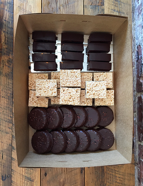 overhead view of a large box of catered treats