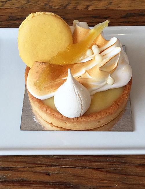 lemon tart with merengue and macaron on top