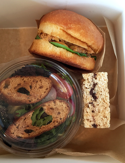 overhead view of boxed lunch featuring the tuna salad sandwich