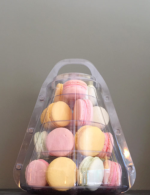 small macaron tower in a portable plastic case