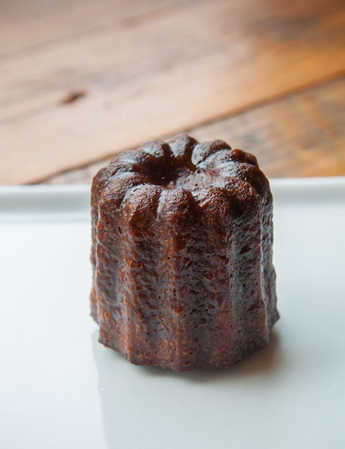 mini canelé, a vanilla rum cake