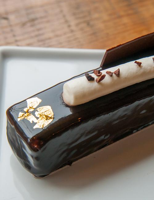 closeup of the edible gold foil on top of larry's meets escazu chocolate dessert