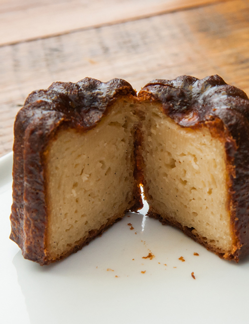inside of the dense vanilla rum cake mini canelé