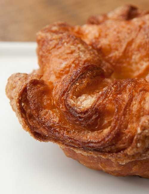 closeup of caramelized sugar layers of the Kouign Amann pastry