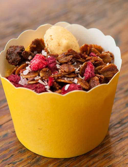 closeup of cereal in a tiny yellow paper cup