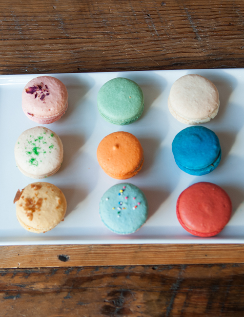 overhead view of macarons on a white plate